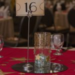 A table centerpiece with a card in the center labeled 16